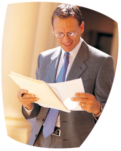 Blue Tie Looking at Papers, roth ira booklet